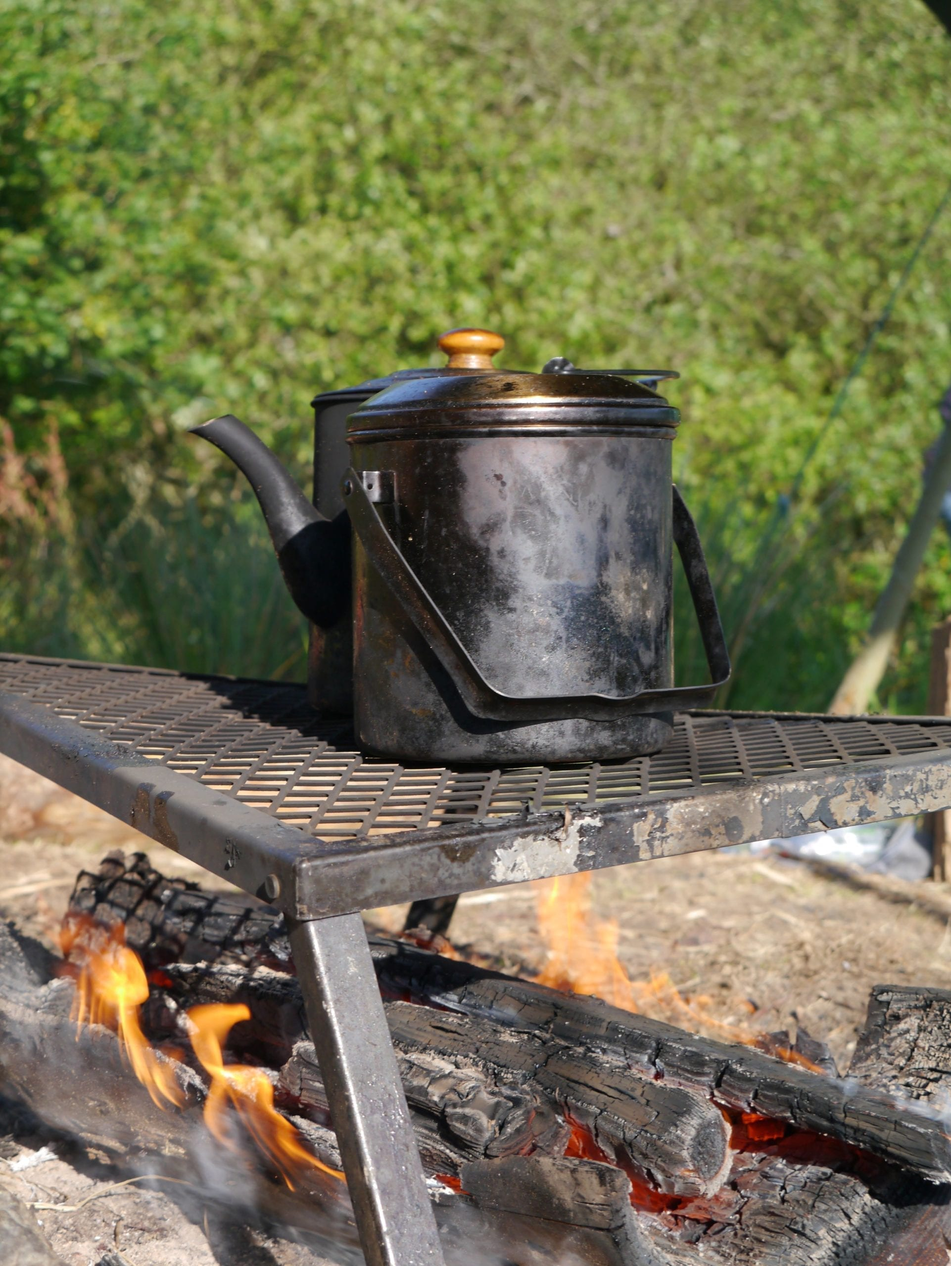 Camp fire with kettles