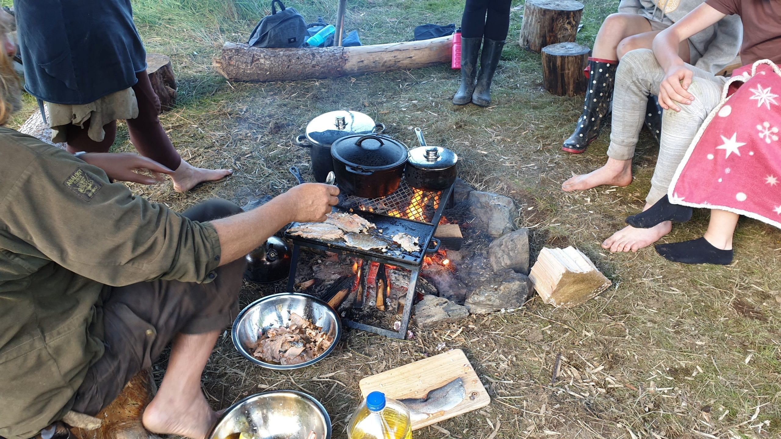 Cooking trout over campfire